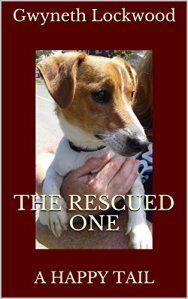 Front cover of my ebook featuring a headshot of a Jack Russell Terrier dog and the title 'The Rescued One; A Happy Tail' and author's name Gwyneth Lockwood. Dark burgundy border.