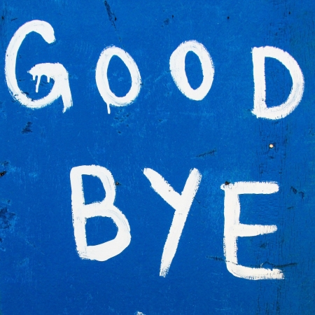 A handwritten sign that says 'Good Bye'. White paint on a dark blue background.