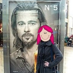 Me standing next to a giant street advert featuring Brad Pitt. My identity is hidden behind a cartoon face with pink hair.