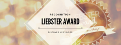Liebster Award logo, black writing within a white diamond on a gold shimmery background.