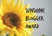 A bright yellow sunflower and the words 'Sunshine Blogger Award'