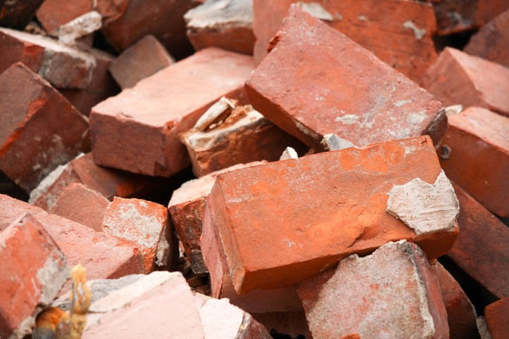 Photo of a pile of red brick rubble.